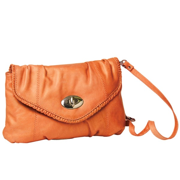 The flap over PUCKER UP CLUTCH features a gathered leather frill edge detail and silver metal turn lock at front. Roomy enough to fit all your essentials plus a little bit more! The strap is adjustable and can be lengthened or shortened to suit, or remove and wear as a clutch.