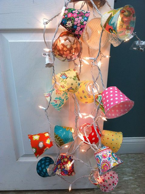 diy lamp shades: Clear plastic cups + Fabric + Elmers glue. Cut an 'X' in the bottom of the cup after fabric has dried, and pop onto christmas lights.