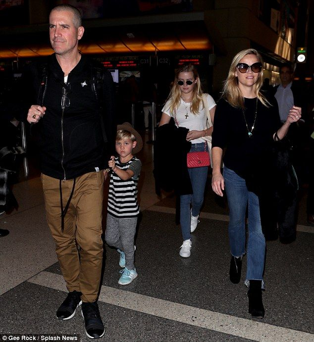 Leaving LA:Reese Witherspoon (far R), 41, was snapped departing out of LAX airport on Tuesday with her family - (L-R) husband Jim Toth, sonTennessee and daughter Ava Phillippe