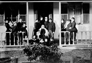 Lady Amelia on the porch of her home with four generations of descendants