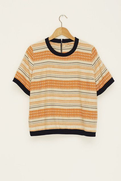 Orange, navy & ivory printed t-shirt. Banded at the cuff & hem. Exposed zipper.