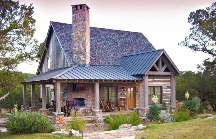 beautiful stone cabin with tall chimney