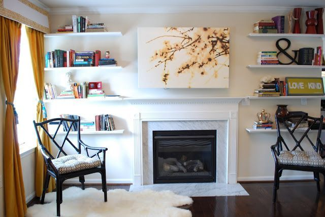 hidden TV — hiding TV — above the fireplace, behind the art. instead of a hinge, it's just lift-off.
