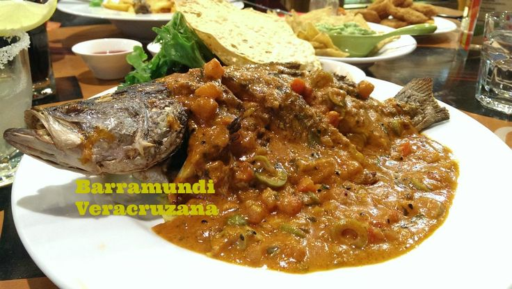 """Barramundi Veracruzana will float your boat for dinner!! It's a whole baby barramundi, seasoned gently, marinated in select spices and grilled then served in a tasty tomato, olive, and caper salsa with steamed rice, chutney and pappadums. Customer overheard at nearby table: """"Ok THAT'S what I'M getting next time!!"""""""