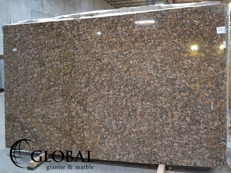 New Giallo Fiorito Dark polished granite slab. Visit globalgranite.com for your natural stone needs.