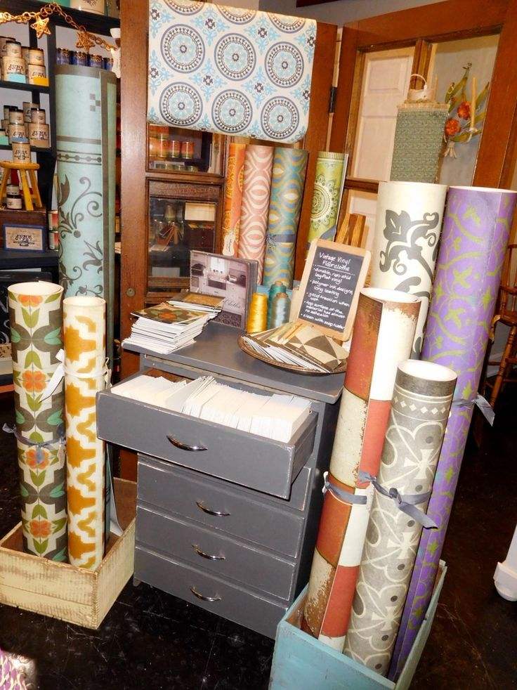 Our Spicher and Co. vintage vinyl floorcloth display in our store, Salvaged.