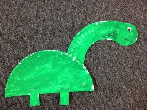 Simple dinosaur crafts - paper plate brontosaurus and hand print stegosaurus. Neat dino songs too.
