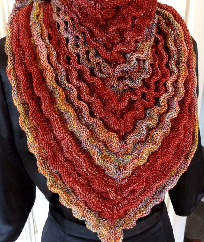 Free Knitting Pattern for Cereza Shawl - This unique triangular shawl features alternating stripes of ribbing and reverse stockinette, that create natural ruching and 3 dimensional ruffles. Designed by Sue Berg. Available in English and German