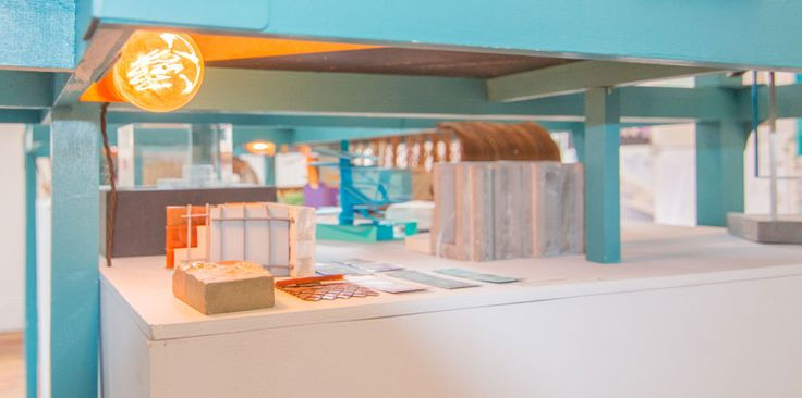 Unit E Exhibition http://theojones.com/project/unit-e/  A teal coloured timber frame floats above the existing flat display surface, lightly touching the ground. The frame allows for a large model with bespoke supports to hover above a lower layer of sketch models, material tests and artifacts related to the same project.  Theo Jones Architecture #design #interior #student #architecture #wood #frame #display #endofyearshow #oxfordbrookes #lighting #bulb
