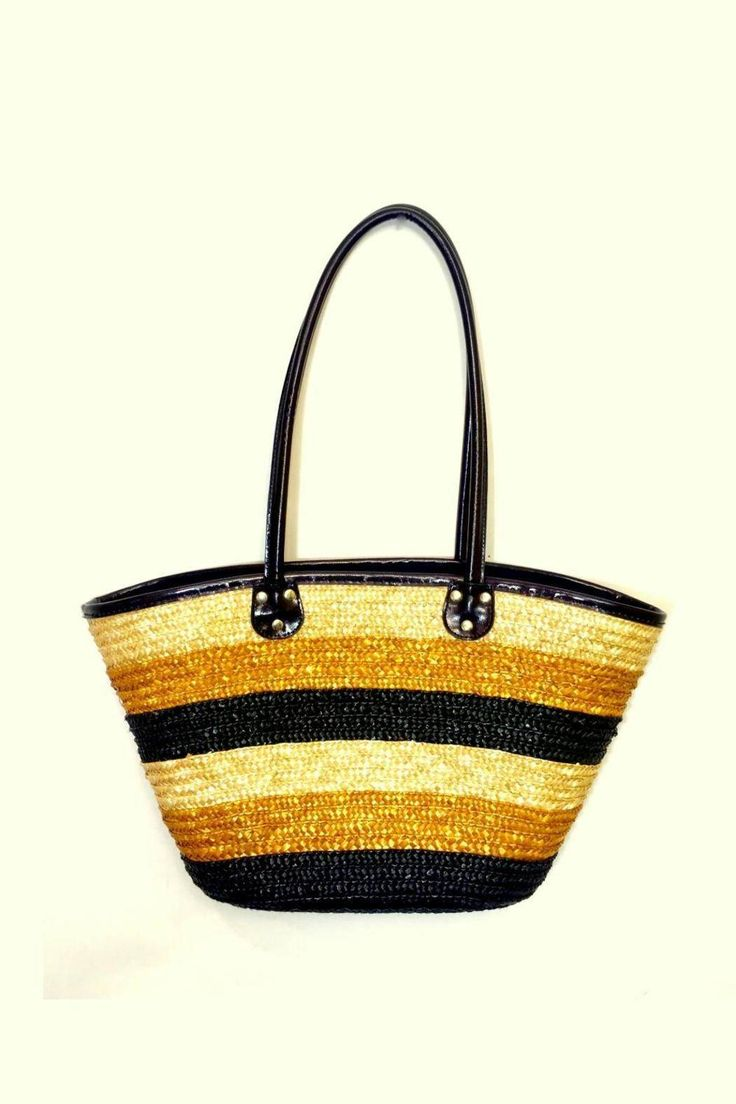 This bag was handmade on the East Coast of Africa in a gorgeous city called Mombasa which is by the Indian Ocean. It has three different shades of dyed straw and is perfect for both the beach as well as formal settings. It snaps shut and has lining and a small additional pocket within for extra storage. Rock this bag to the beach when on vacation (or if you are lucky enough to live by the ocean/ water) or for a casual lunch/ brunch with friends. Pair it with culottes and a vacation hat and…