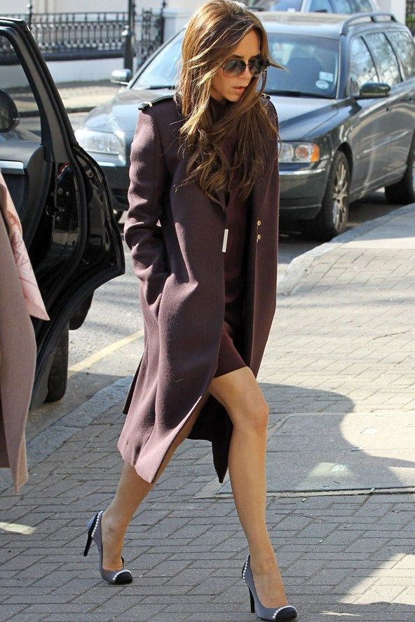 Victoria Beckham was spotted out in London wearing a maroon dress and coat with pretty pearl embellished round-toe pumps.