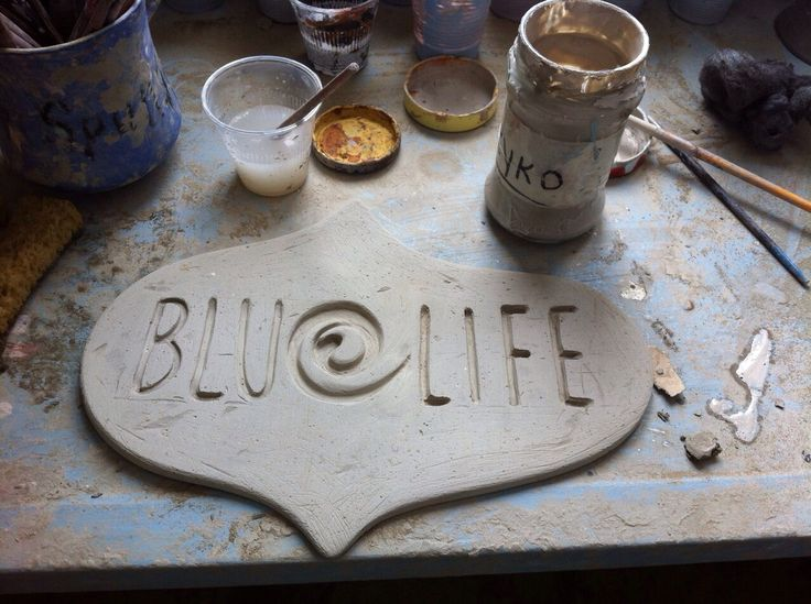 sanding the clay once it is dry and shape the corners. This will be the sign outside of the hotel and this is the logo!