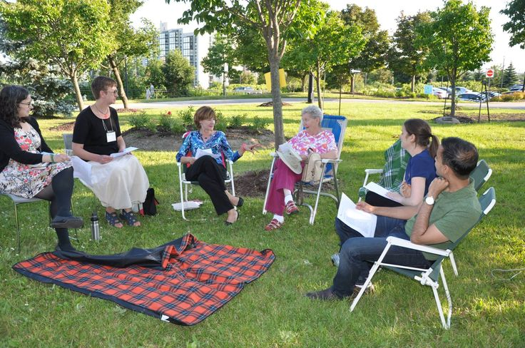 Chairs, Books and Blankets Book Chat on the front lawn at Central Library includes great conversations and ice cold lemonaide!