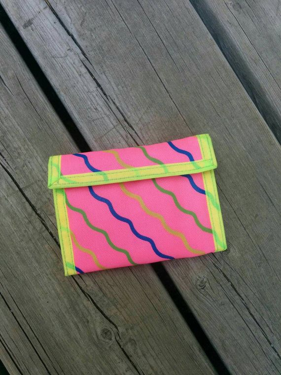 Check out this item in my Etsy shop https://www.etsy.com/listing/476376891/vintage-1980s-neon-trifold-wave-wallet