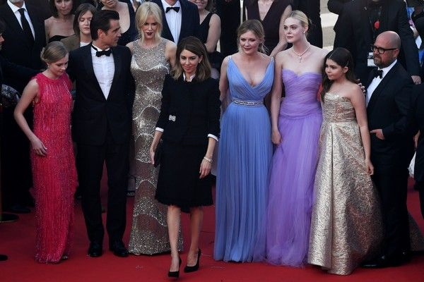 Kirsten Dunst Photos Photos - US director Sofia Coppola (C) arrives on May 24, 2017 with Australian actress Angourie Rice (L), Irish actor Colin Farrell (2ndL), Australian actress Nicole Kidman (3rdL), US actress Kirsten Dunst (4thR), US actress Elle Fanning (3rdR), US actress Addison Riecke (2ndR) and US producer Youree Henley (R) for the screening of the film 'The Beguiled' at the 70th edition of the Cannes Film Festival in Cannes, southern France.  / AFP PHOTO / Antonin THUILLIER - 'The…