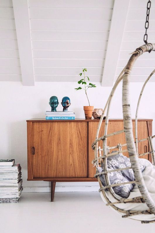 a swing chair and a mid-century modern credenza, via lovely life.