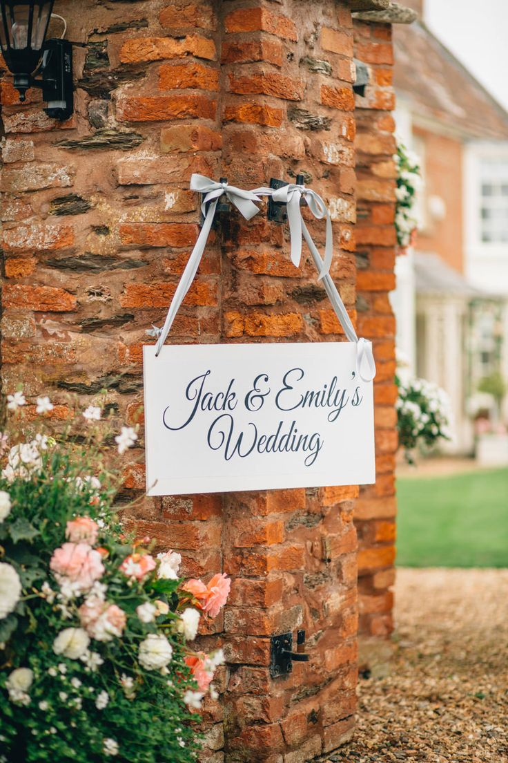 Personalised Wooden Wedding Plaque Sign | Bride in Gracie Suzanne Neville Wedding Dress | Grey Coast Bridesmaid Dresses | Traditional Church Ceremony and Marquee Reception | DIY Decor | Pink Flowers | Image by Joseph-Hall Photography | http://www.rockmywedding.co.uk/emily-jack/