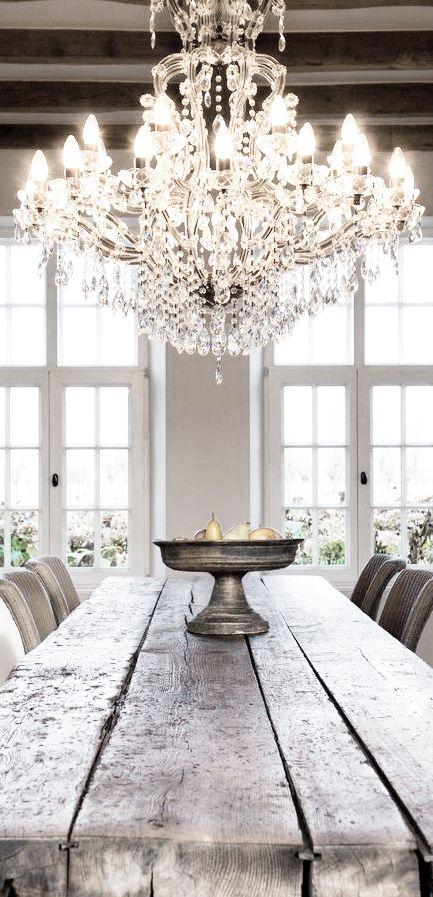 chandelier + rustic wood table .