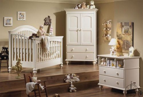 I LOVE this nursery.  The step in the room, the white furniture, the light wood flooring.  It's simply BEAUTIFUL!