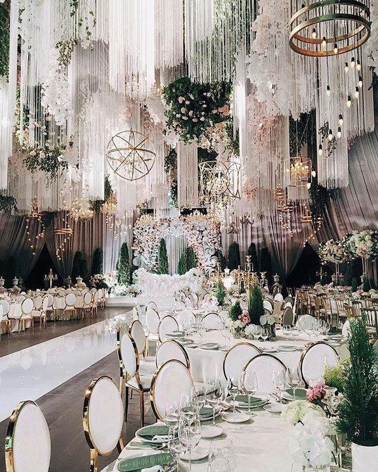 Opulent wedding decor for a glam Gatsby themed celebration. Those gold rimmed chairs are just perfect!