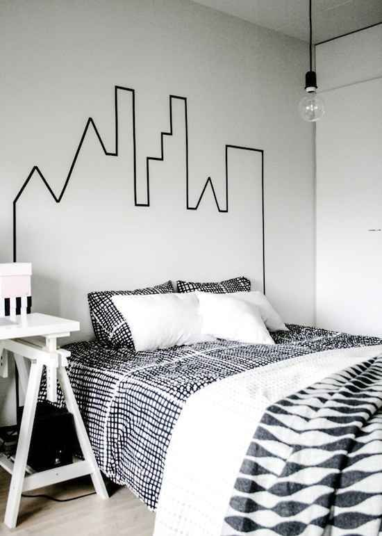 Use masking tape to create a skyline headboard.