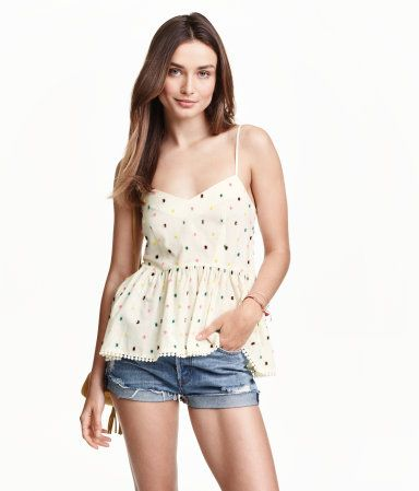 Peplum camisole top in an airy cotton blend with woven, fringed dots. V-neck, narrow shoulder straps, and concealed back zip. Extra-wide hem with decorative trim. Slightly longer at back.