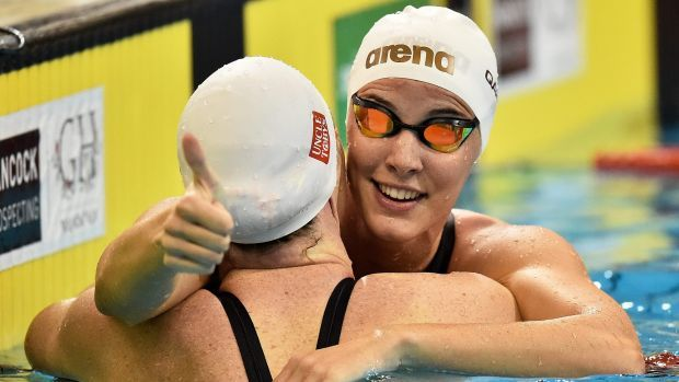 Following close behind: Bronte Campbell, right, celebrates with sister Cate…