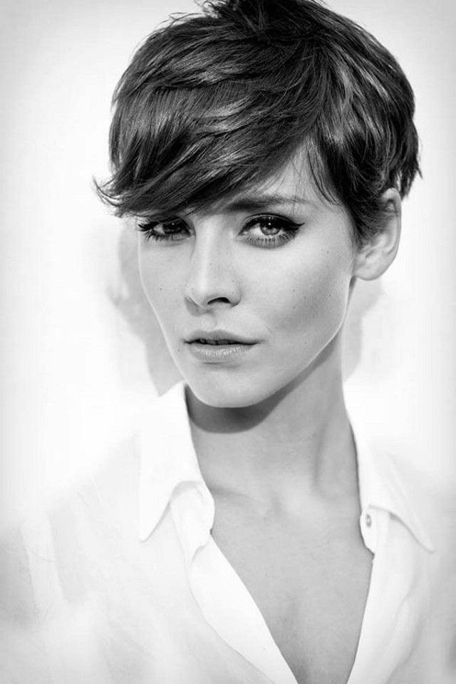 """This super short, choppy pixie cut has an eye-skimming fringe that would flatter a longer face. A great one for anyone with well-behaved hair aka the kind that's naturally""""wash and wear""""."""