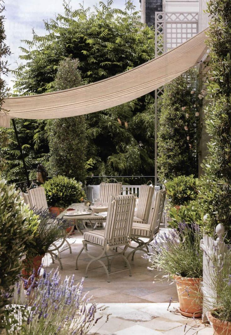 Terrace of Paris apartment of Lauren Santo Domingo. Designer Francois Catroux. Via Vogue sept. 2012. Photography Norman Jean Roy.