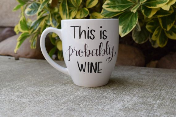 This is probably wine. Unique and Cute.  The word wine can be replaced with anything! Whiskey, Rum, Vodka etc.  Each mug is handpainted by me on a