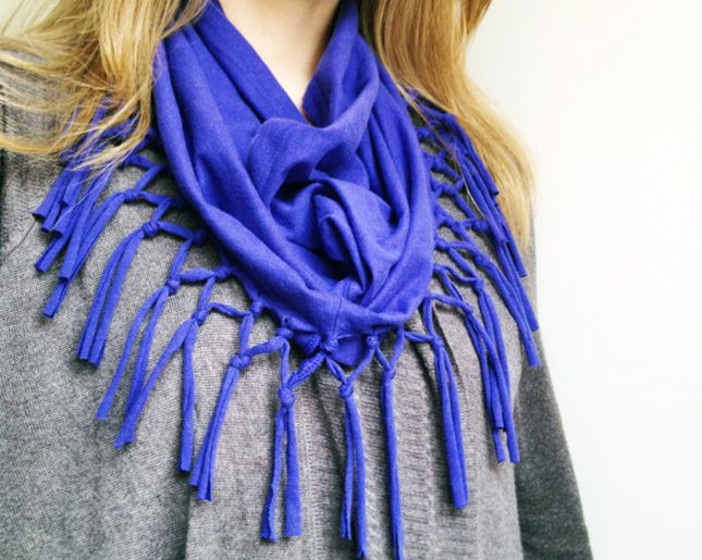 Cut under the sleeves of an old t-shirt and fringe the hemline to get this super simple no-sew circle scarf.
