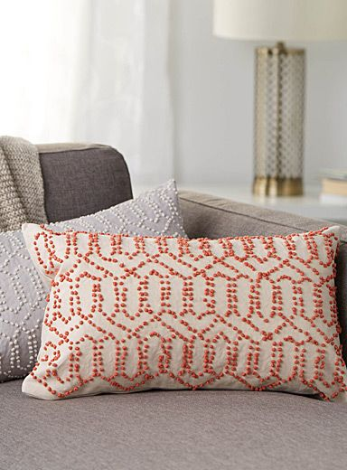 "The Jay St. Block Print Company at Simons Maison.  Designed in Brooklyn and handmade in India, this collection combines artisanal workmanship with an assuredly modern vision.  Small appliqué pompoms provide a decorative accent to this 100% woven cotton cushion, creating an ultra trendy geo lattice pattern.    Match with duvet covers from the same collection   Completely solid underside   Washable with removable cover and a hidden zip on the edging   12"" x 21"""