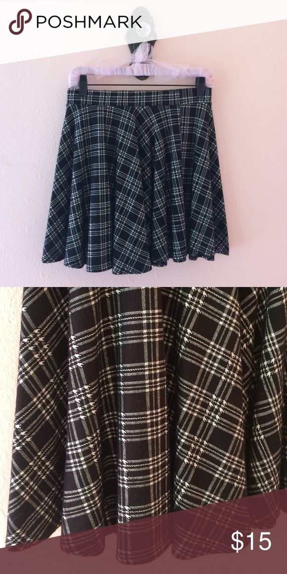 Plaid Mini Skirt In perfect condition. Never worn. Elastic waistband and soft stretchy material. Get the catholic school girl look! Forever 21 Skirts Mini