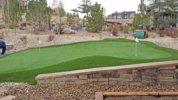 Backyard artificial putting green in Highlands Ranch, CO installed by PlushGrass.