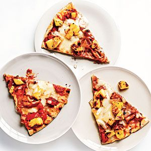 Grilled Ham and Pineapple Pizza Recipe -- Two slices are a serving at 292 calories and 9.6 grams of fat.