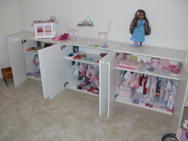 Hoping I can pull this off for her. Just one cabinet, stuffed full of clothing and accessories for her new doll. Might be asking Nancy for some ideas on how to pretty the cabinet up!