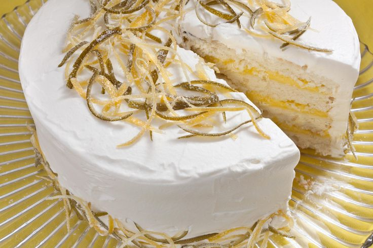 This light and citrusy dessert recipe has white cake layered with lemon-lime curd and topped with whipped cream and candied citrus zest.