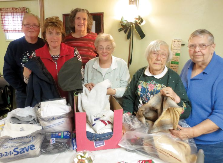 Shawano County - Donation to Homeless Shelter - The Shawano County Farm Bureau women's committee collected winter clothing to donate to a local homeless shelter instead of having a gift exchange during the annual Christmas party in conjunction with their December committee meeting.