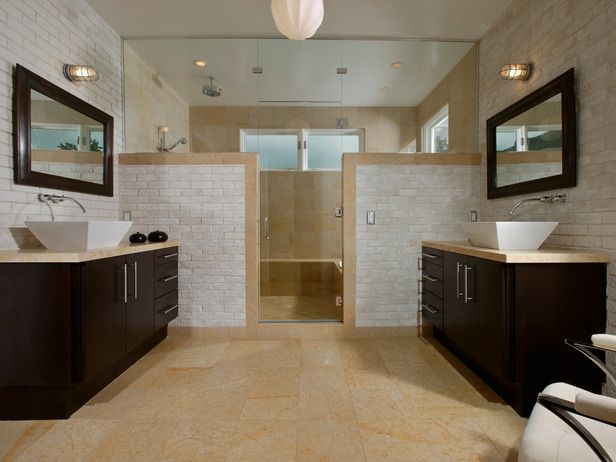 Neutral colors, natural materials and a symmetrical floor plan contribute to the spa-like serenity in this bathroom.