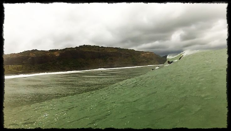 A perfect wave peels into Maori Bay as a surfer paddles to drop in. Photo taken by Hayden Brown using GoPro camera.
