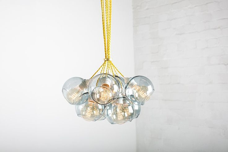 The Atom Chandelier is available in a variety of different tints and sizes