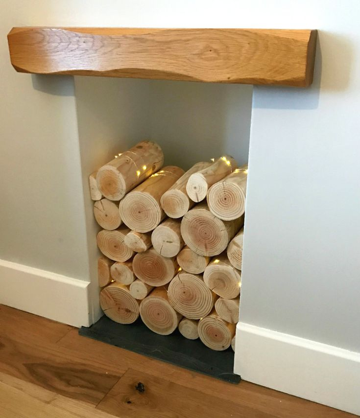 You don't need to completely fill an empty fireplace with decorative logs to create an eye-catching feature in your home as part of your interior design / home decor. Part-fill the empty alcove recess with a stack of our natural whole round logs for display, thread through some micro fairy lights and enjoy the effect / styling for years to come.