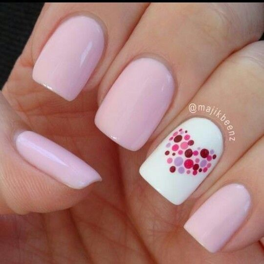 Romantic heart nail art from polka dots.