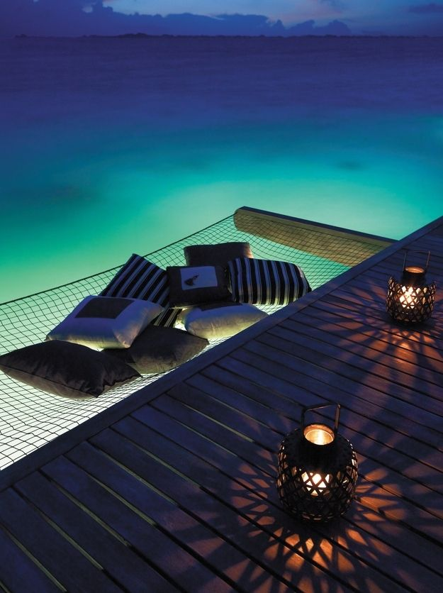 In a lantern-lit hammock over the sea. | Community Post: 44 Amazing Places You Wish You Could Nap Right Now