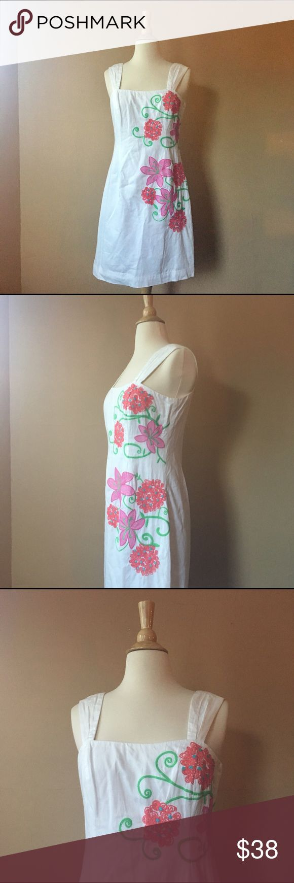 Lilly Pulitzer White dress with floral embroidery Lilly Pulitzer White dress with floral embroidery, Straight line, zipper on the back, fully lined 100% cotton, Size 4 Bust: 16in, Waist: 15in Length: 36inches from shoulder down Lilly Pulitzer Dresses