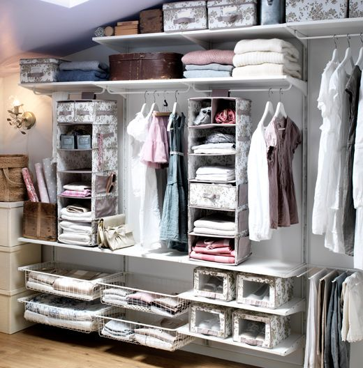 Storage solution with ALGOT shelves, wire baskets, trouser hanger, rods and wall uprights