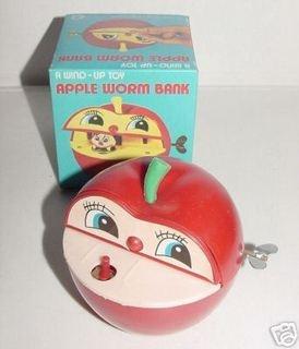 La mala salvadanaio! Si appoggiava la moneta sul pulsante, la mela si apriva e il bruco afferrava la moneta coi suoi dentoni e la trascinava dentro!