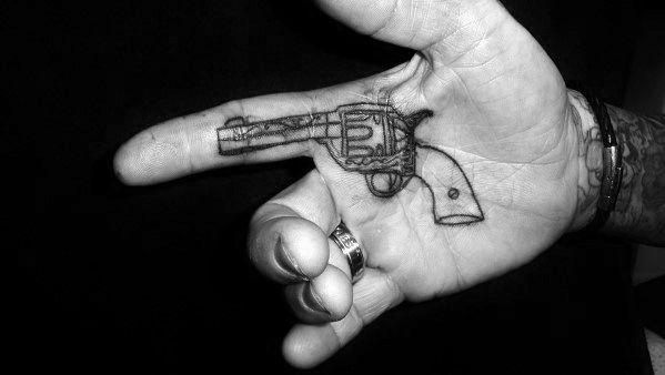Guys Simple Hand Revolver Palm Tattoo Design Idea Inspiration