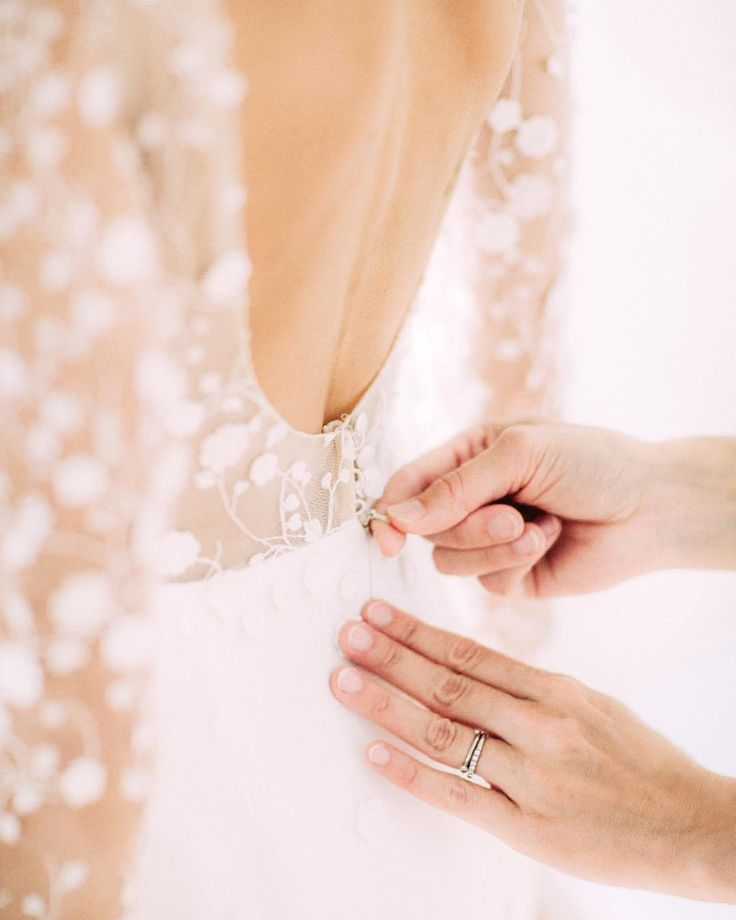 Me slippin' into my Rime Arodaky dress on our wedding day - Anna, Arctic Vanilla blog. Photo by Petra Veikkola.