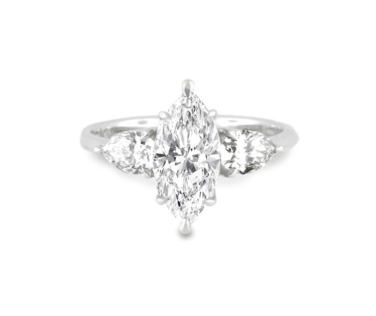 An 18ct White Gold and Diamond Trilogy Ring with a Marquise Cut Center Stone and Two Pear Shaped Side Stones